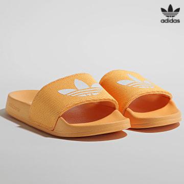 https://laboutiqueofficielle-res.cloudinary.com/image/upload/v1627646526/Desc/Watermark/3adidas_orginal.svg Adidas Originals - Claquettes Femme Adilette FX5925 Hazy Orange Cloud White