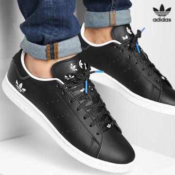 https://laboutiqueofficielle-res.cloudinary.com/image/upload/v1627646526/Desc/Watermark/3adidas_orginal.svg Adidas Originals - Baskets Stan Smith H05341 Core Black Blue Bird Cloud White
