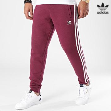 https://laboutiqueofficielle-res.cloudinary.com/image/upload/v1627646526/Desc/Watermark/3adidas_orginal.svg Adidas Originals - Pantalon Jogging A Bandes H06687 Bordeaux