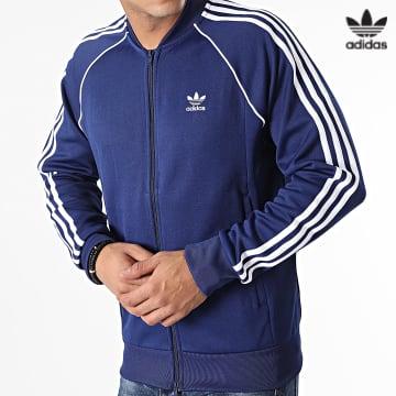 https://laboutiqueofficielle-res.cloudinary.com/image/upload/v1627646526/Desc/Watermark/3adidas_orginal.svg Adidas Originals - Veste Zippée A Bandes SST H06710 Bleu Marine