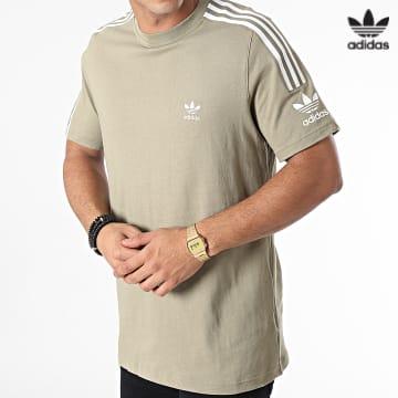 https://laboutiqueofficielle-res.cloudinary.com/image/upload/v1627646526/Desc/Watermark/3adidas_orginal.svg Adidas Originals - Tee Shirt A Bandes Tech H40349 Vert Kaki