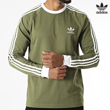 https://laboutiqueofficielle-res.cloudinary.com/image/upload/v1627646526/Desc/Watermark/3adidas_orginal.svg Adidas Originals - Tee Shirt Manches Longues A Bandes 37779 Vert Kaki