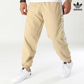 https://laboutiqueofficielle-res.cloudinary.com/image/upload/v1627646526/Desc/Watermark/3adidas_orginal.svg Adidas Originals - Pantalon Jogging A Bandes H41385 Beige