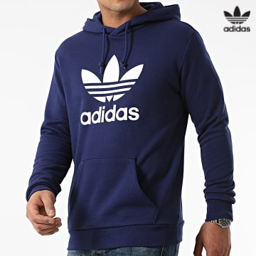 https://laboutiqueofficielle-res.cloudinary.com/image/upload/v1627646526/Desc/Watermark/3adidas_orginal.svg Adidas Originals - Sweat Capuche Trefoil H06666 Bleu Marine
