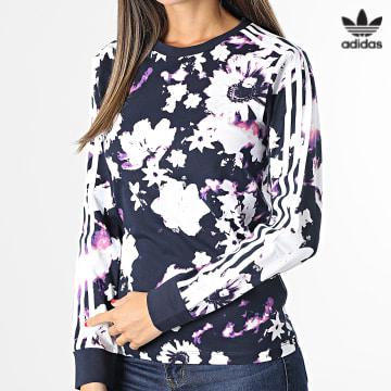 https://laboutiqueofficielle-res.cloudinary.com/image/upload/v1627646526/Desc/Watermark/3adidas_orginal.svg Adidas Originals - Tee Shirt Manches Longues Femme A Bandes H20409 Bleu Marine Blanc Floral