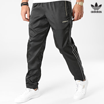 https://laboutiqueofficielle-res.cloudinary.com/image/upload/v1627646526/Desc/Watermark/3adidas_orginal.svg Adidas Originals - Pantalon Jogging A Bandes Satin H31292 Noir Doré