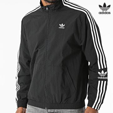 https://laboutiqueofficielle-res.cloudinary.com/image/upload/v1627646526/Desc/Watermark/3adidas_orginal.svg Adidas Originals - Veste Zippée A Bandes Lock Up H41391 Noir