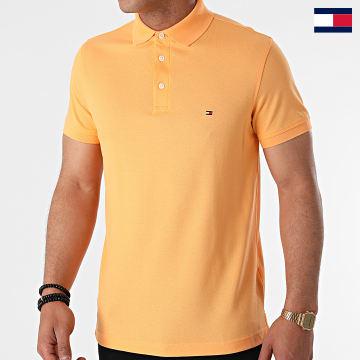 https://laboutiqueofficielle-res.cloudinary.com/image/upload/v1627647047/Desc/Watermark/7logo_tommy_hilfiger.svg Tommy Hilfiger - Polo Manches Courtes 1985 Slim 7771 Orange