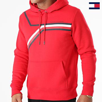 https://laboutiqueofficielle-res.cloudinary.com/image/upload/v1627647047/Desc/Watermark/7logo_tommy_hilfiger.svg Tommy Hilfiger - Sweat Capuche Split Corp Stripe 1115 Rouge