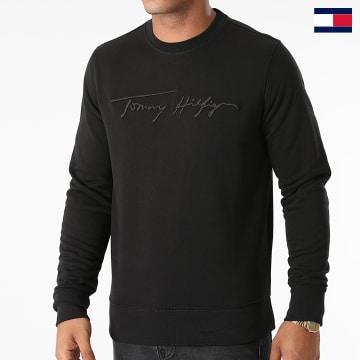 https://laboutiqueofficielle-res.cloudinary.com/image/upload/v1627647047/Desc/Watermark/7logo_tommy_hilfiger.svg Tommy Hilfiger - Sweat Crewneck Signature 8710 Noir