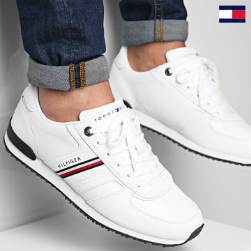 https://laboutiqueofficielle-res.cloudinary.com/image/upload/v1627647047/Desc/Watermark/7logo_tommy_hilfiger.svg Tommy Hilfiger - Iconic Leather Runner Stripes 3923 White
