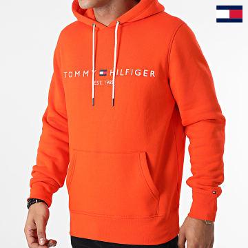 https://laboutiqueofficielle-res.cloudinary.com/image/upload/v1627647047/Desc/Watermark/7logo_tommy_hilfiger.svg Tommy Hilfiger - Sweat Capuche Tommy Logo 1599 Orange