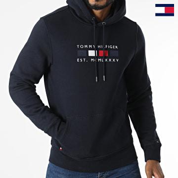 https://laboutiqueofficielle-res.cloudinary.com/image/upload/v1627647047/Desc/Watermark/7logo_tommy_hilfiger.svg Tommy Hilfiger - Sweat Capuche Four Flag 0132 Bleu Marine