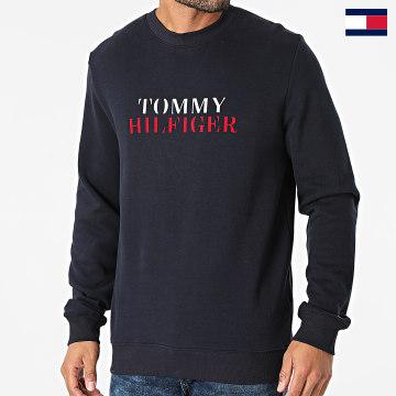 https://laboutiqueofficielle-res.cloudinary.com/image/upload/v1627647047/Desc/Watermark/7logo_tommy_hilfiger.svg Tommy Hilfiger - Sweat Crewneck Track 2366 Bleu Marine