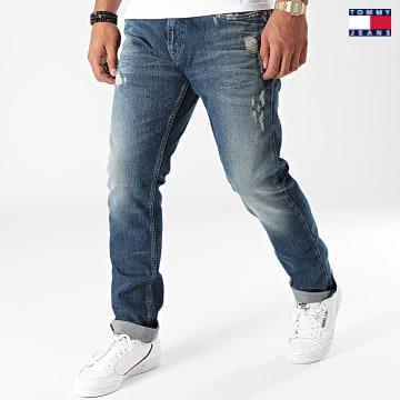 https://laboutiqueofficielle-res.cloudinary.com/image/upload/v1627651009/Desc/Watermark/3logo_tommy_jeans.svg Tommy Jeans - Jean Slim Scanton 1562 Bleu Denim