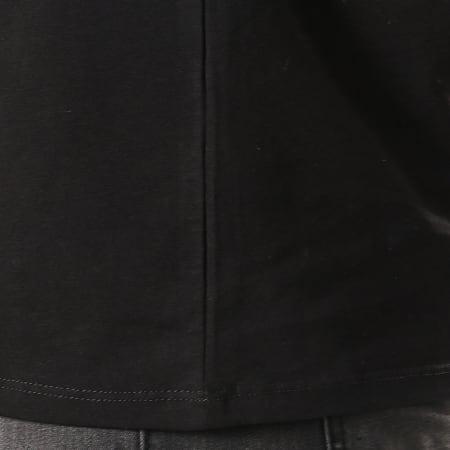 Guess - Polo Manches Longues M94P36-J1300 Noir Gris