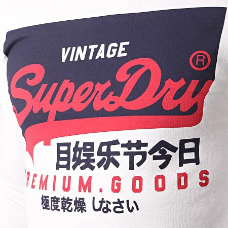 Superdry - Tee Shirt Manches Longues VL O M6010048A Blanc Bleu Marine
