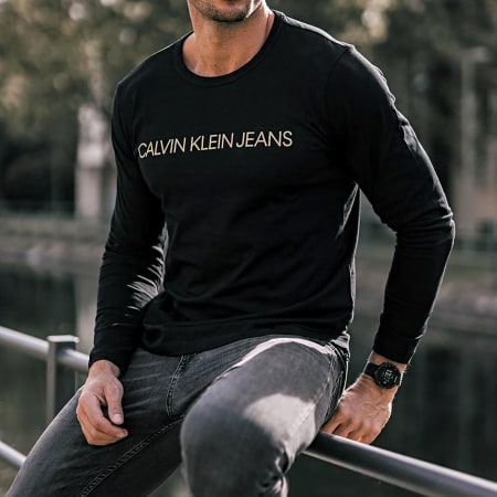 Calvin Klein - Tee Shirt Manches Longues Gold Institutional 7721 Noir Doré