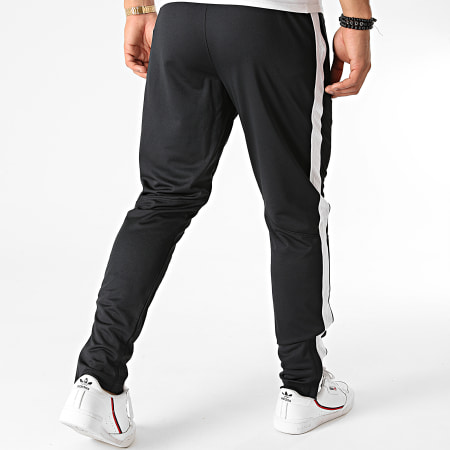 Under Armour - Pantalon Jogging 1313201 Noir Blanc