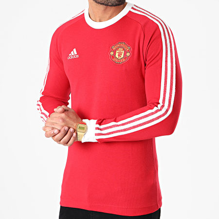 adidas - Tee Shirt Manches Longues A Bandes Manchester United Icons FR3853 Rouge Blanc
