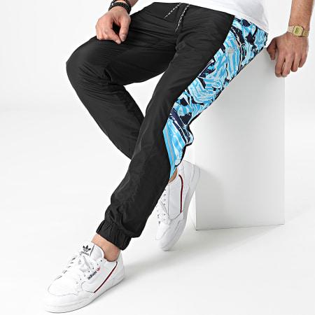 Puma - Pantalon Jogging A Bandes OM TFS 758736 Noir Bleu Clair