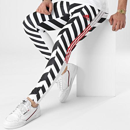 adidas - Pantalon Jogging A Bandes Manchester United FC AOP GK9435 Blanc Noir