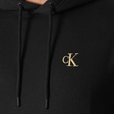 Calvin Klein Jeans - Sweat Capuche 9789 Noir Doré