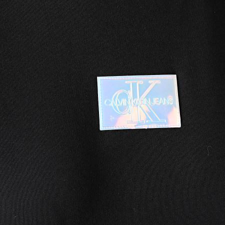 Calvin Klein Jeans - Tee Shirt Femme Shine Badge 6184 Noir Iridescent