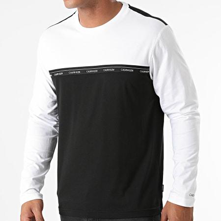 Calvin Klein - Tee Shirt Manches Longues Logo Stripe 7311 Noir Blanc