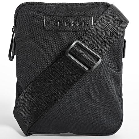 Calvin Klein Jeans - Sacoche Code Flatpack 7320 Noir