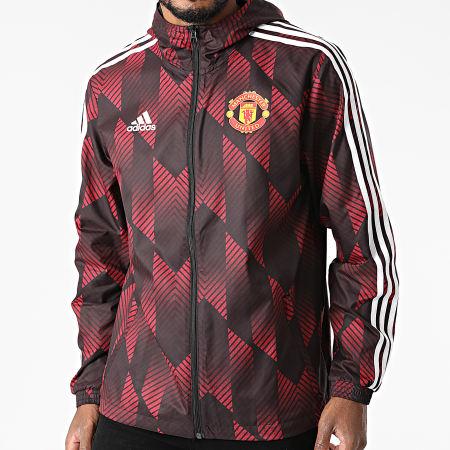 adidas - Coupe-Vent Capuche A Bandes Manchester United FC GR3872 Bordeaux