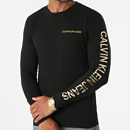 Calvin Klein Jeans - Tee Shirt Manches Longues Institutional 0547 Noir Doré